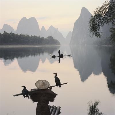 Cormorant fishermen in Li River-Martin Puddy-Photographic Print