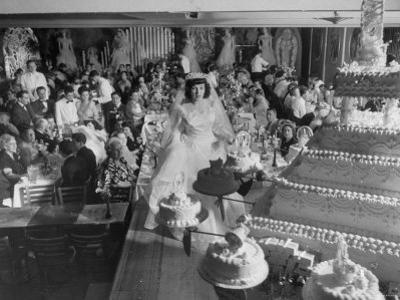At Palumbo's Cafe, Bride Mrs. Salvatore Cannella Walks Onto Stage, Facing a Revolving Cake Display