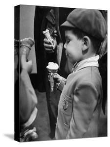 Boy Eating Ice Cream Cone at the Circus in Madison Square Garden by Cornell Capa