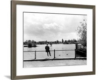 British Actor Alec Guinness Sitting Alone by Lake in a Park