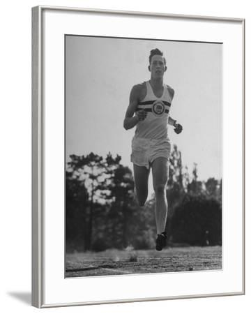 British Track Runner Roger Bannister Running, the First Person to Run a Mile in under Four Minutes
