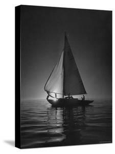 Full Sails During a Night Sailboat Race, with the Sun Peeking over the Horizon by Cornell Capa