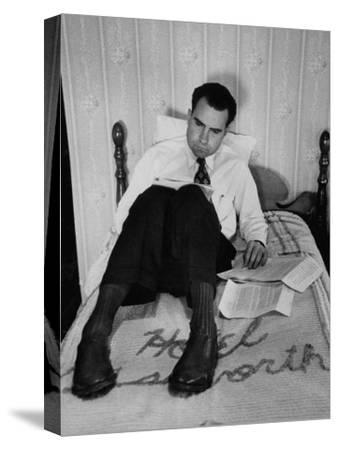 Vice Presidential Candidate Richard M. Nixon Sitting on His Hotel Bed Reviewing Paperwork