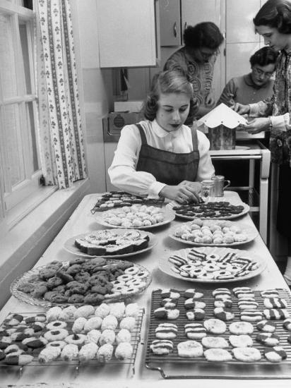 Cornell's Home Economics Student Lois Schumacher prepares food, Classmates Help with Decorations-Nina Leen-Photographic Print