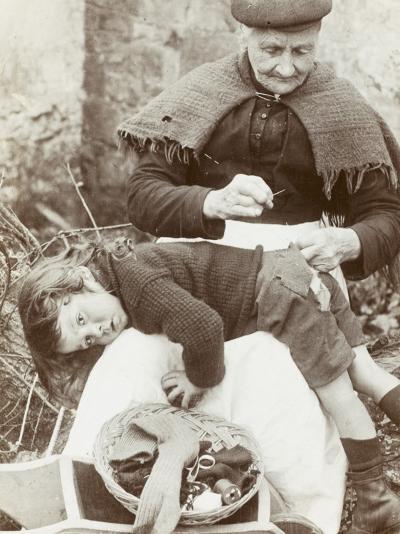 Cornish Grandmother Repairs Her Grandson's Clothing--Photographic Print