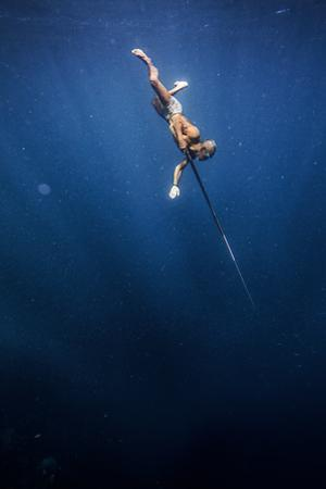 A Bajo elder of Sampela, spear fishing on the reef. by Cory Richards
