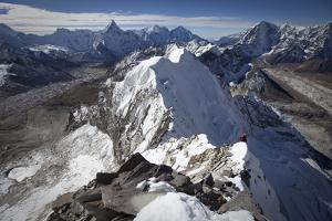 A Climber Leads Through Broken Terrain on the West Ridge of Nuptse by Cory Richards