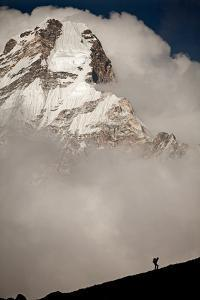 A Climber Walks Below the Southwest Ridge of Ama Dablam in the Khumbu Region of Nepal by Cory Richards