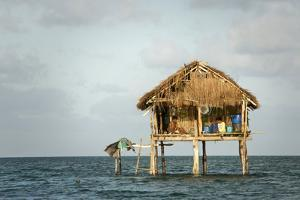 A Couple Sit in their Traditional Bajo Home on the Outskirts of Sampela by Cory Richards