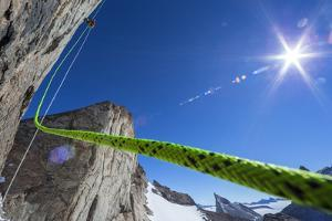 A Mountaineer Ascends a Fixed Rope on the Final Summit Push of Bertha's Tower, a 2,000-Foot Spire by Cory Richards