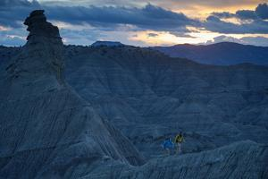 A Paleontologist and Volunteer Walk a Ridgeline in the Fossil Rich Badlands of Southern Utah by Cory Richards