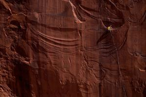 A Rock Climber on a Sandstone Splitter in Day Canyon Outside Moab by Cory Richards