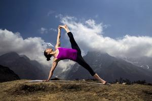 A Woman Practices a Side Plank Pose or Vasisthasana in Phortse by Cory Richards
