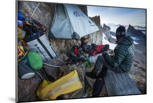 Expedition Team Members Try to Stay Warm on a Ledge of Bertha's Tower,1,200 Feet Above the Ground by Cory Richards