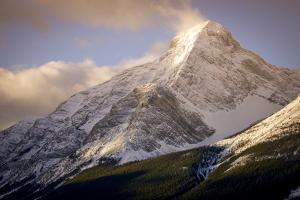 Sunrise on a Snow Capped Mountain Peak by Cory Richards