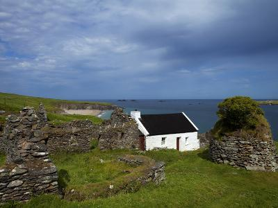 Cottage And Deserted Cottages on Great Blasket Island--Photographic Print