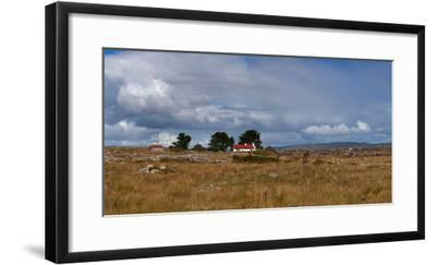 Cottage and Rocky Barren Landscape on Lettermore Island, Connemara, County Galway, Ireland