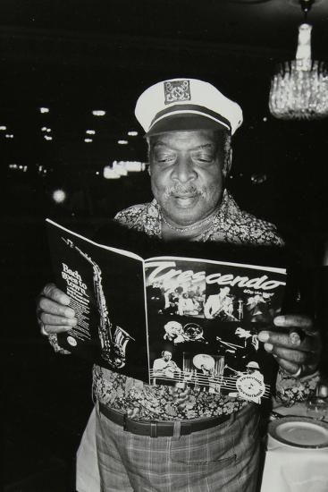 Count Basie Reading a Copy of Crescendo Magazine at the Grosvenor House Hotel, London, 1979-Denis Williams-Photographic Print