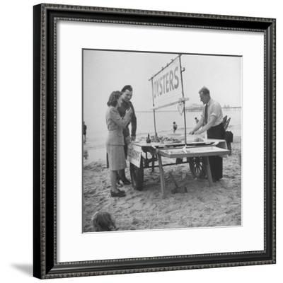 Couple Buying Seafood at Blackpool Beach-Ian Smith-Framed Premium Photographic Print