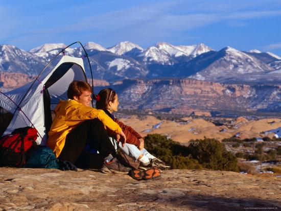 Couple Camping at Slickrock with Snow-Capped Peaks in the Background, Utah, USA-Cheyenne Rouse-Photographic Print