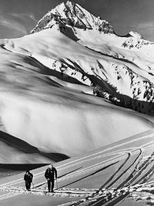 Couple Cross-Country Skiing in Mountains