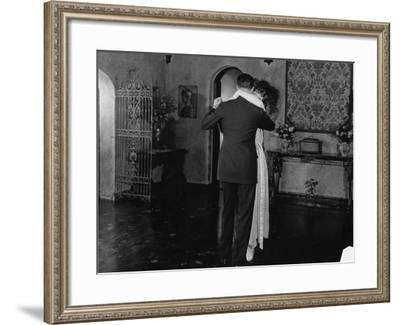 Couple Dancing at Home--Framed Photo