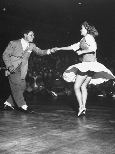 Couple Dancing in a Jitterbug Contest--Photographic Print