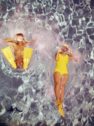 Couple Diving in Swimming Pool-Dennis Hallinan-Photographic Print