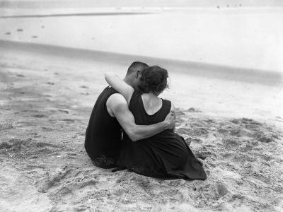 Couple Embracing on Beach--Photographic Print