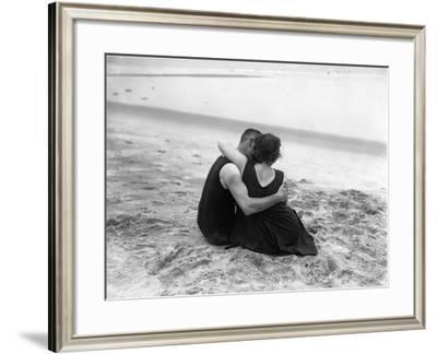 Couple Embracing on Beach--Framed Photographic Print
