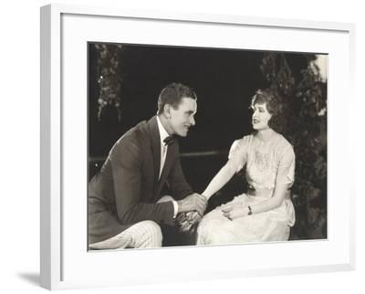 Couple Holding Hands in Park--Framed Photo