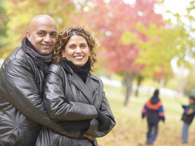 Couple in the Park with Children in the Background--Photographic Print