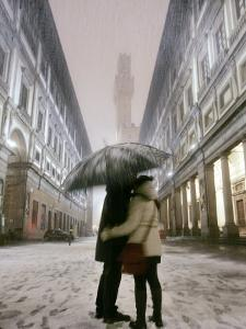 Couple Kiss Each Other During a Snowfall in Florence, Italy