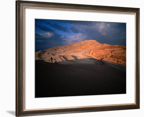 Couple of Hikers Walking Through Shadows at Dusk, Valle De La Luna, Chile-Aaron McCoy-Framed Photographic Print