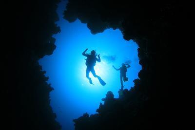Couple of Scuba Divers Descend into an Underwater Cavern-Rich Carey-Photographic Print