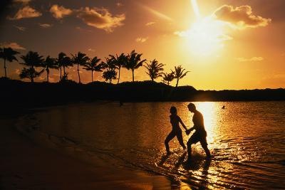 Couple on Beach at Sunset.-Linda Ching-Photographic Print
