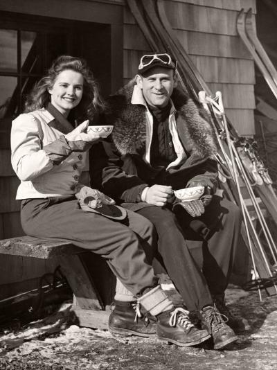 Couple Outside Ski Lodge-George Marks-Photographic Print