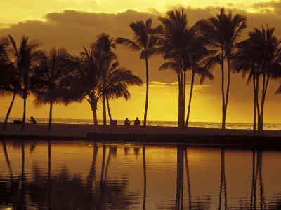 Couple, Palm Trees and Sunset Reflecting in Lagoon at Anaeho'omalu Bay, Big Island, Hawaii, USA-John & Lisa Merrill-Photographic Print