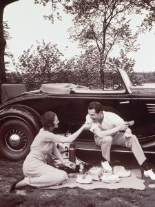 Couple Picnicking, Man Sitting on Car Runningboard