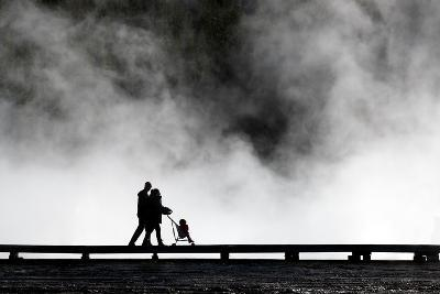 Couple Push Their Baby On Boardwalk At Grand Prismatic Spring In Yellowstone NP In Autumn-Ben Herndon-Photographic Print