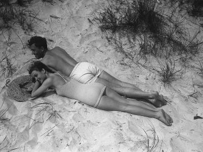 Couple Relaxing on Beach, Elevated View-George Marks-Photographic Print
