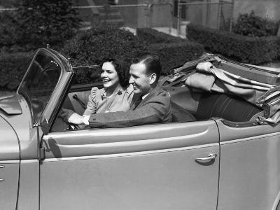 Couple Riding in Old Fashion Convertible Car-George Marks-Photographic Print