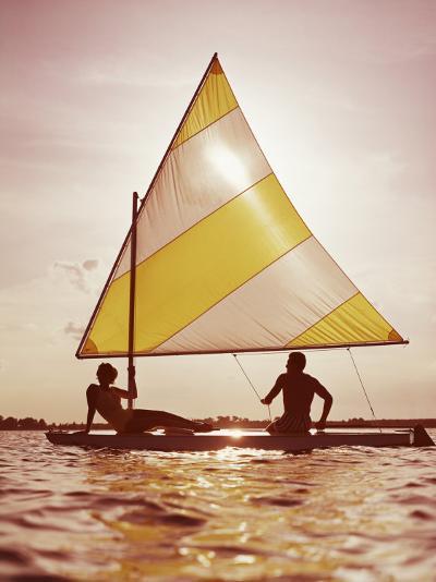 Couple Sailing on Small Boat-Dennis Hallinan-Photographic Print