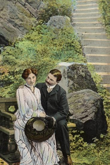 Couple Seated on a Stone Bench Near Some Steps--Photographic Print