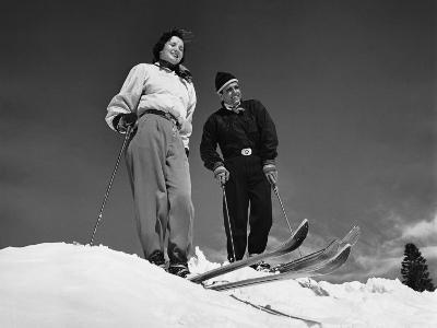 Couple Skiing, Stopped at Top of Hill--Photographic Print