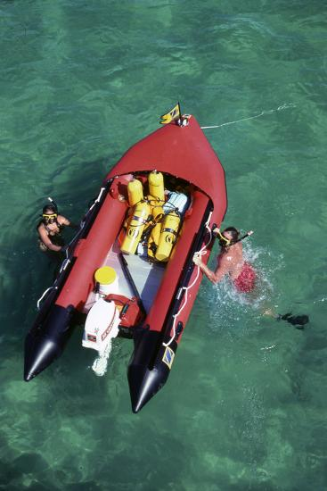 Couple Snorkeling Off their Dinghy in Biscayne Bay, C.1990--Photographic Print
