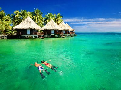 Couple Snorkling in Tropical Lagoon with over Water Bungalows-Martin Valigursky-Photographic Print