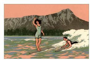 Couple Surfing at Diamond Head