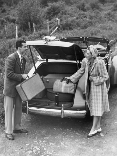 Couple Unloading Luggage From Trunk of Car-George Marks-Photographic Print