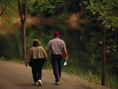 Couple Walking by the Water Along a Park Road-Raymond Gehman-Photographic Print